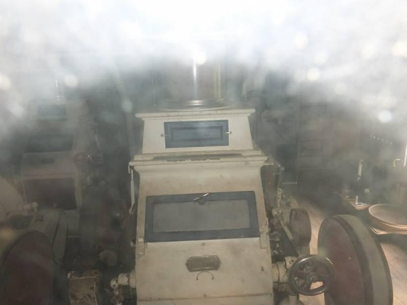 Machine à moudre le grain au moulin de Faye
